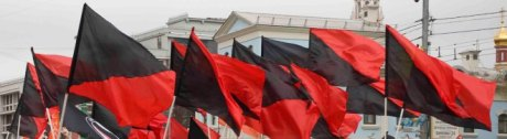 Red and Black flags flying